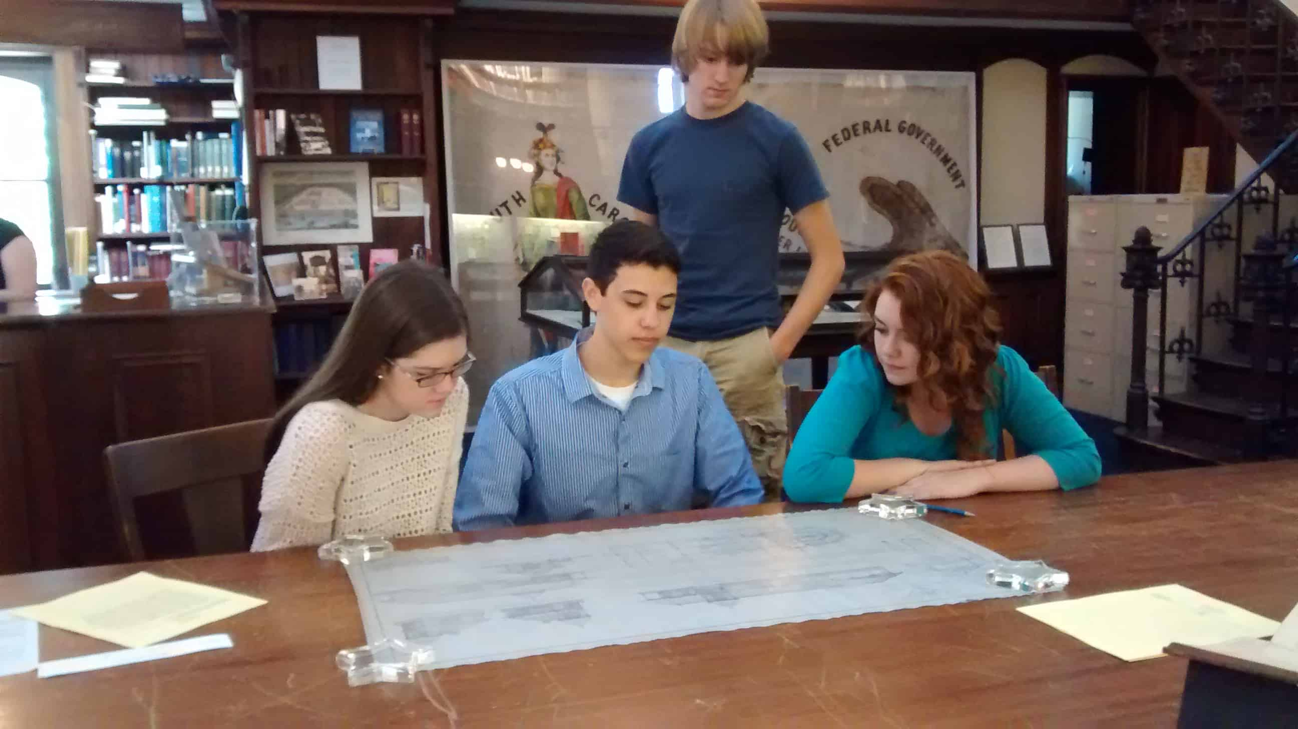 High School Students Investigating Railroad Depot Blue Prints at GHS
