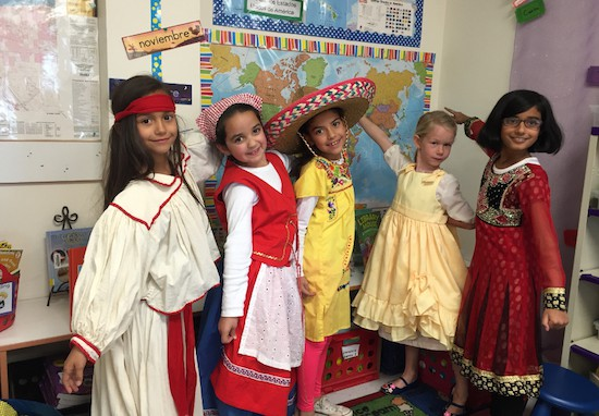 Girls doing performance assessment project in traditional clothing from various cultures