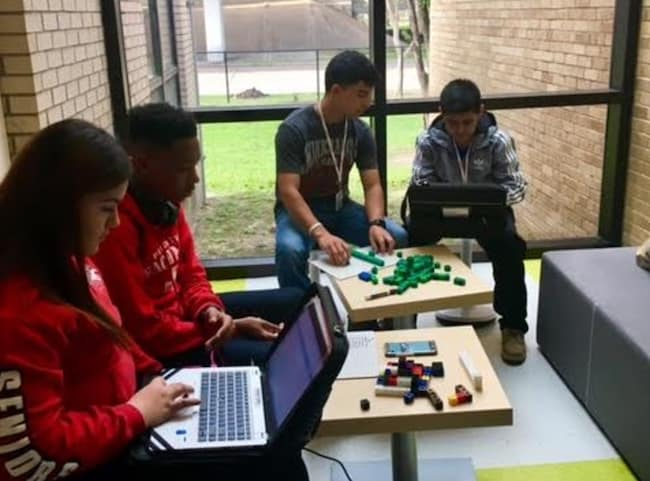 students at a houston school working on projects and computers