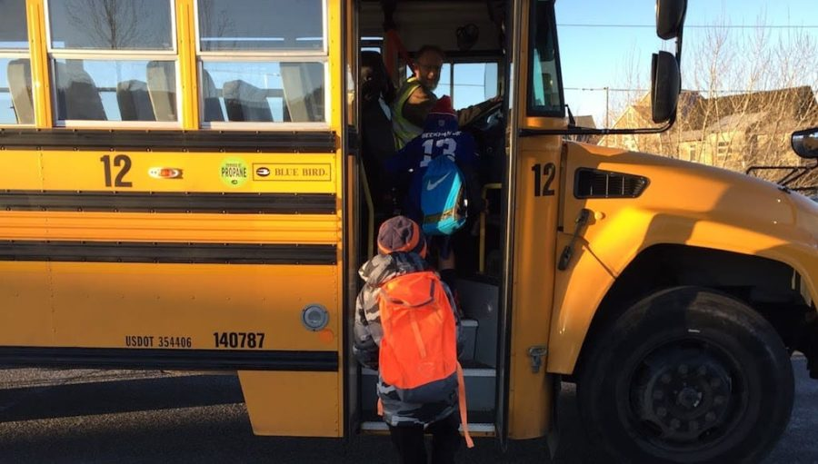First person view of someone taking the shadow a student challenge that is following a child stepping on to school bus