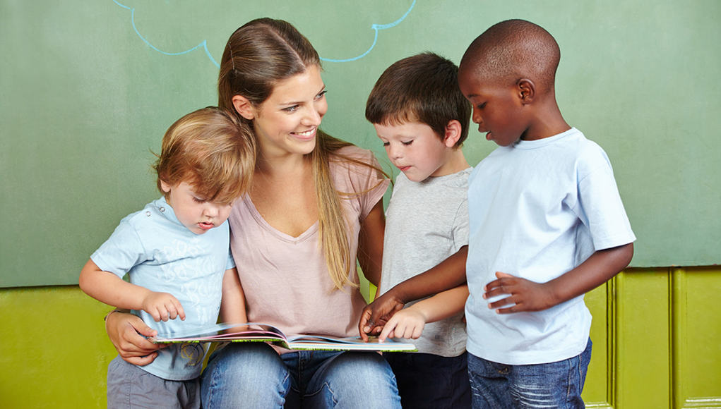 Teacher Reading to Young Students Early Learning Feature Image